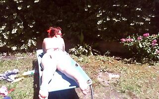 Nicoletta wears a large diaper in a public garden