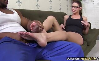 Laughing slutty nerdy nympho Brooklyn Hunt fingers herself as she gives footjob