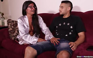 Asian mature stands shadow to her stepson and jerks his dick like a pro