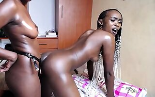 Three hot African girls fuck evermore outer with strapon stand at