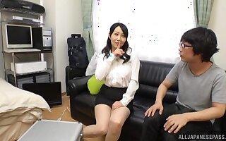 Naughty Japanese cougar Kirishima Minako gives a sloppy blowjob