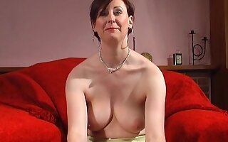 Horny MILF Lara Latex plays with her round boobs and shaved pussy