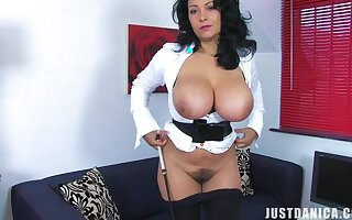 Foxy mature Danica Collins takes off her clothes and teases