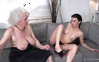 Busty pornstar Tiffany Doll in lesbo scene with granny Norma B