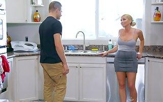 Mature blonde Christie Stevens gives a massage using her boobs