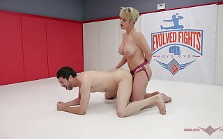 Dee Williams uses a large strapon to fuck her male opponent