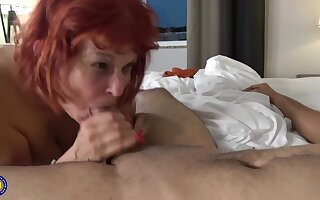 Red haired, American mature veldt stockings likes to shot casual sexual intercourse with younger guys