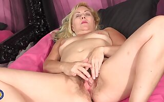 Horny blonde granny is often masturbating plus even using sex toys, as far as something it feels much set to rights